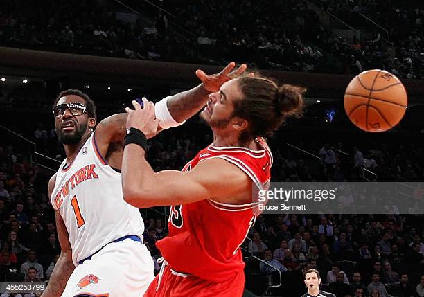 Amar'e Stoudemire of the New York Knicks knocks the ball away from Joakim Noah of the Chicago Bulls at Madison Square Garden on December 11 2013 in...