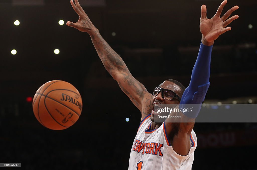 Amar'e Stoudemire #1 of the New York Knicks looks to block a pass against the Boston Celtics at Madison Square Garden on January 7, 2013 in New York City.