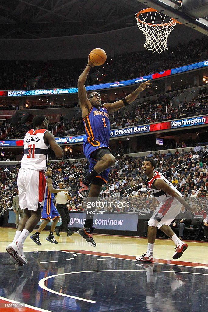 Amare Stoudemire #1 of the New York Knicks puts up a shot in front of <a gi-track='captionPersonalityLinkClicked' href=/galleries/search?phrase=Chris+Singleton&family=editorial&specificpeople=241555 ng-click='$event.stopPropagation()'>Chris Singleton</a> #31 and Nick Young #1 of the Washington Wizards during the first half at Verizon Center on January 6, 2012 in Washington, DC.