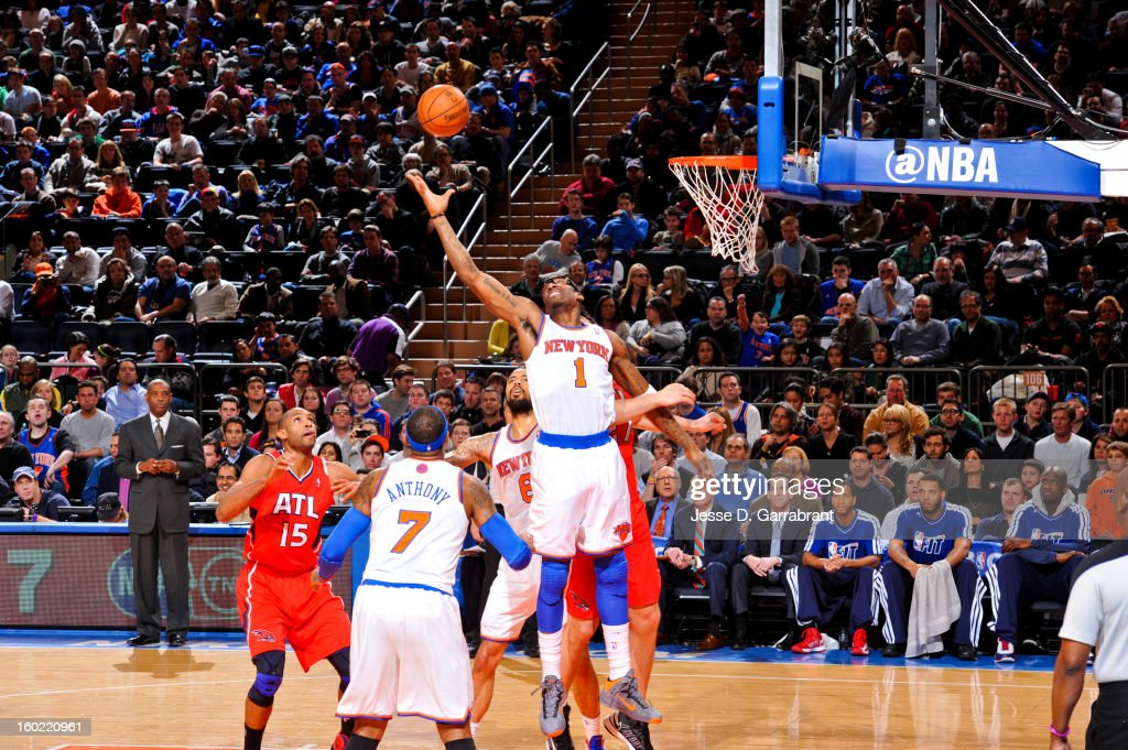 Amar'e Stoudemire #1 of the New York Knicks reaches for a rebound against the Atlanta Hawks at Madison Square Garden on January 27, 2013 in New York, New York.