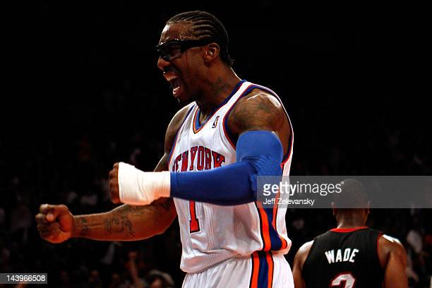 Amare Stoudemire of the New York Knicks reacts after he dunked in the first half against the Miami Heat in Game Four of the Eastern Conference...
