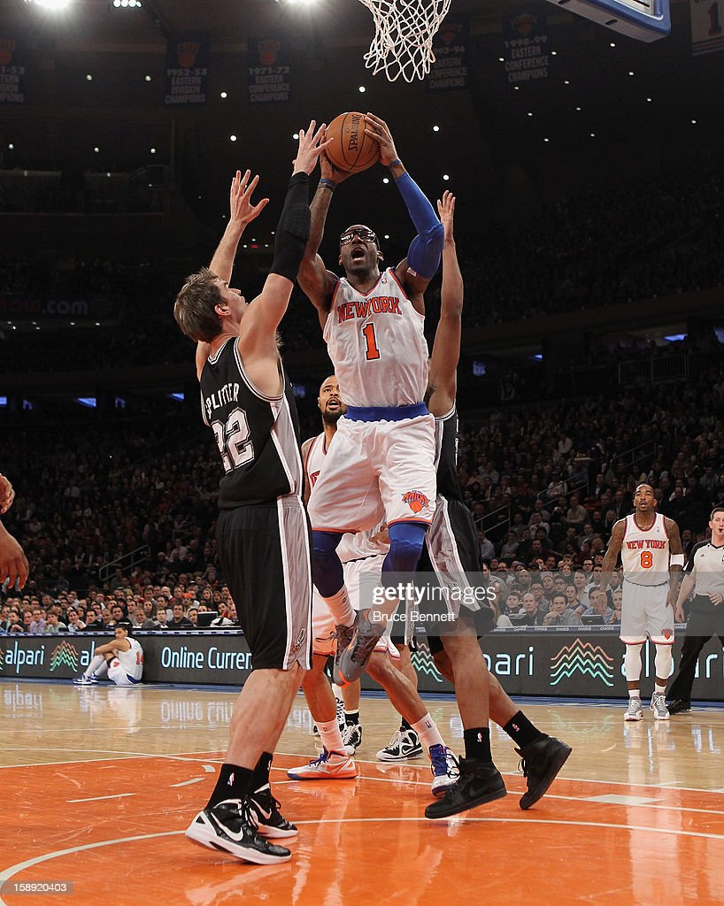 Amar'e Stoudemire #1 of the New York Knicks scores two in the first quarter against the San Antonio Spurs at Madison Square Garden on January 3, 2013 in New York City.