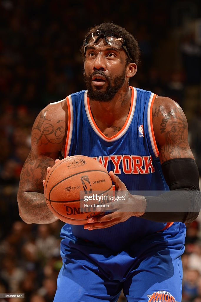 <a gi-track='captionPersonalityLinkClicked' href=/galleries/search?phrase=Amar%27e+Stoudemire&family=editorial&specificpeople=201492 ng-click='$event.stopPropagation()'>Amar'e Stoudemire</a> #1 of the New York Knicks shoots a free throw during the game against the Toronto Raptors on December 28, 2013 at the Air Canada Centre in Toronto, Ontario, Canada.
