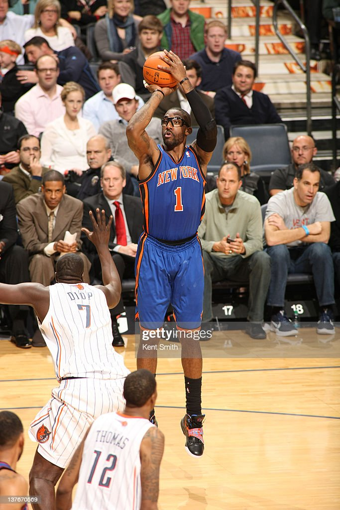 Amar'e Stoudemire #1 of the New York Knicks shoots against <a gi-track='captionPersonalityLinkClicked' href=/galleries/search?phrase=DeSagana+Diop&family=editorial&specificpeople=213233 ng-click='$event.stopPropagation()'>DeSagana Diop</a> #7 and <a gi-track='captionPersonalityLinkClicked' href=/galleries/search?phrase=Tyrus+Thomas&family=editorial&specificpeople=453285 ng-click='$event.stopPropagation()'>Tyrus Thomas</a> #12 of the Charlotte Bobcats during the game at the Time Warner Cable Arena on January 24, 2012 in Charlotte, North Carolina.