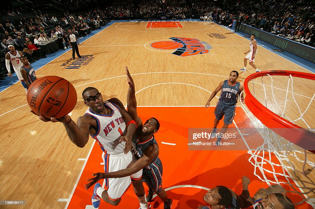 Amar'e Stoudemire #1 of the New York Knicks shoots against D.J. White #8 of the Charlotte Bobcats on January 9, 2012 at Madison Square Garden in New York City.