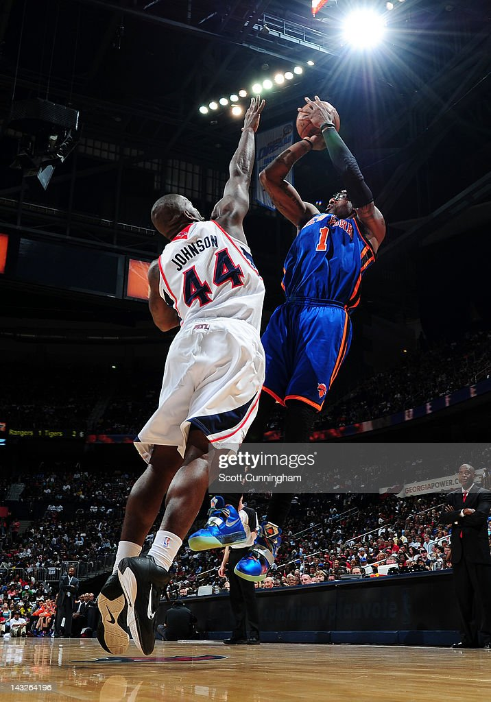 <a gi-track='captionPersonalityLinkClicked' href=/galleries/search?phrase=Amar%27e+Stoudemire&family=editorial&specificpeople=201492 ng-click='$event.stopPropagation()'>Amar'e Stoudemire</a> #1 of the New York Knicks shoots against Ivan Johnson #44 of the Atlanta Hawks on April 22, 2012 at Philips Arena in Atlanta, Georgia.