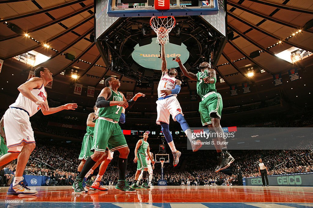 Amar'e Stoudemire #1 of the New York Knicks shoots against <a gi-track='captionPersonalityLinkClicked' href=/galleries/search?phrase=Jared+Sullinger&family=editorial&specificpeople=6866665 ng-click='$event.stopPropagation()'>Jared Sullinger</a> #7 and <a gi-track='captionPersonalityLinkClicked' href=/galleries/search?phrase=Kevin+Garnett&family=editorial&specificpeople=201473 ng-click='$event.stopPropagation()'>Kevin Garnett</a> #5 of the Boston Celtics on January 7, 2013 at Madison Square Garden in New York City.