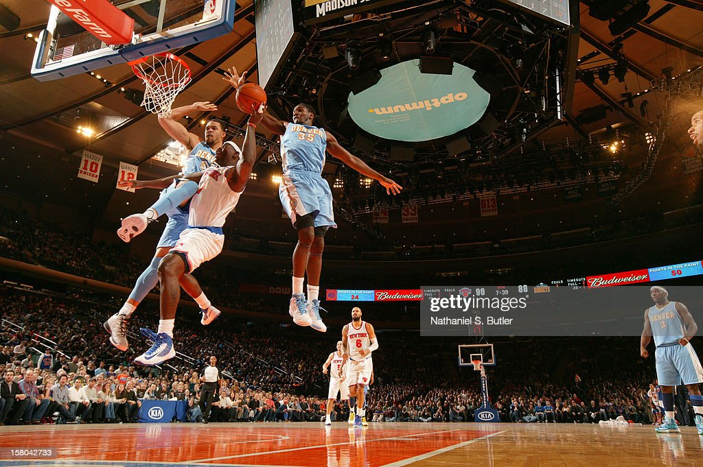 Amar'e Stoudemire #1 of the New York Knicks shoots against <a gi-track='captionPersonalityLinkClicked' href=/galleries/search?phrase=Ty+Lawson&family=editorial&specificpeople=4024882 ng-click='$event.stopPropagation()'>Ty Lawson</a> #3 and <a gi-track='captionPersonalityLinkClicked' href=/galleries/search?phrase=Kenneth+Faried&family=editorial&specificpeople=5765135 ng-click='$event.stopPropagation()'>Kenneth Faried</a> #35 of the Denver Nuggets on December 9, 2012 at Madison Square Garden in New York City.