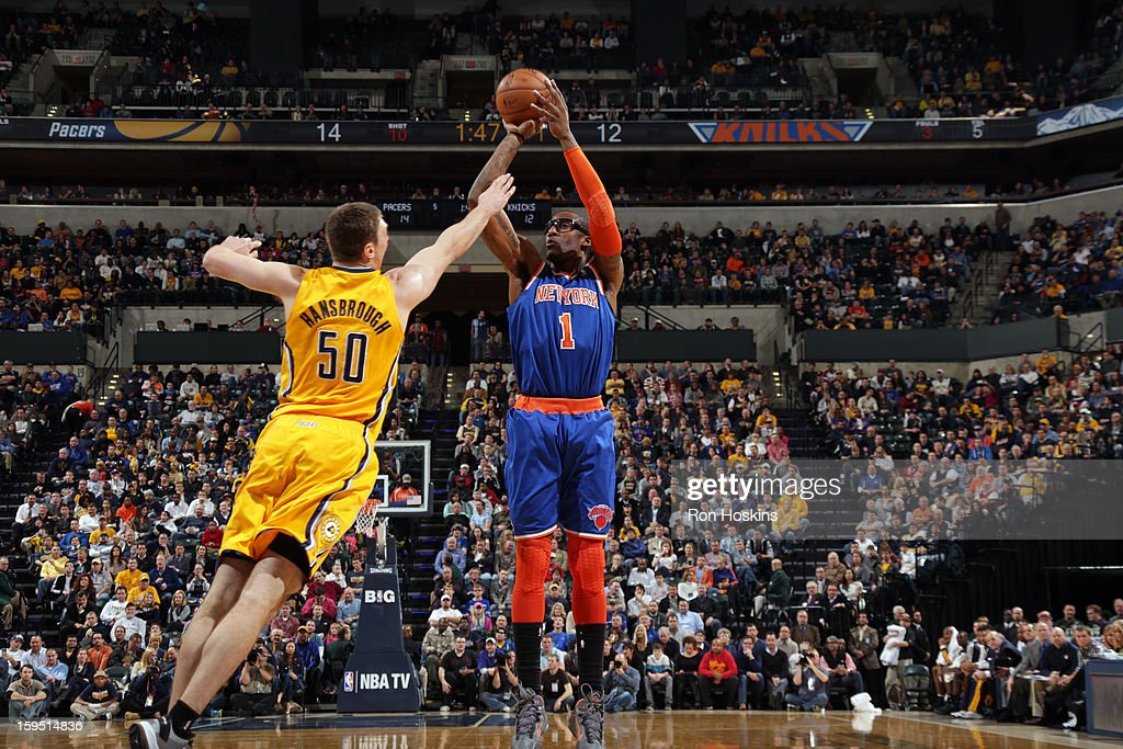 Amar'e Stoudemire #1 of the New York Knicks shoots against <a gi-track='captionPersonalityLinkClicked' href=/galleries/search?phrase=Tyler+Hansbrough&family=editorial&specificpeople=642794 ng-click='$event.stopPropagation()'>Tyler Hansbrough</a> #50 of the Indiana Pacers on January 10, 2013 at Bankers Life Fieldhouse in Indianapolis, Indiana.