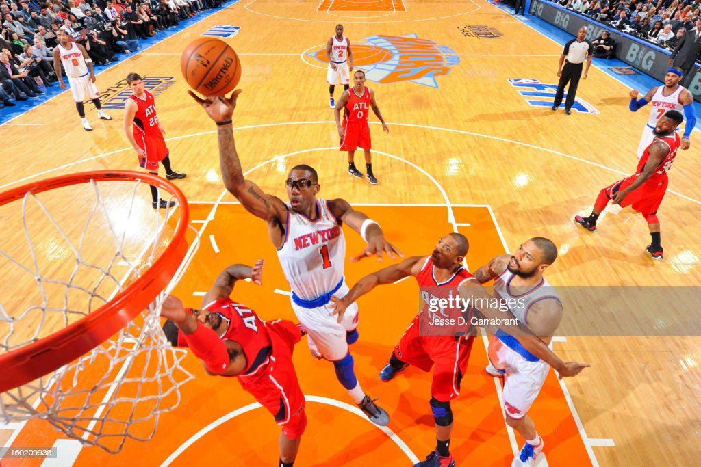Amar'e Stoudemire #1 of the New York Knicks shoots in the lane against Josh Smith #5 of the Atlanta Hawks at Madison Square Garden on January 27, 2013 in New York, New York.