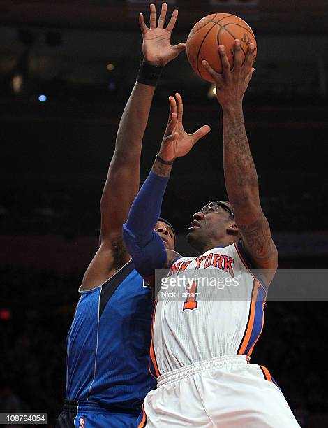 Amar'e Stoudemire of the New York Knicks shoots the b all against Brendan Haywood of the Dallas Mavericks at Madison Square Garden on February 2 2011...