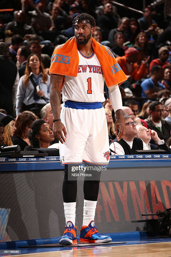 Amar'e Stoudemire #1 of the New York Knicks stands on the side of court waiting to get in the game against the Atlanta Hawks during a game at Madison Square Garden in New York City.
