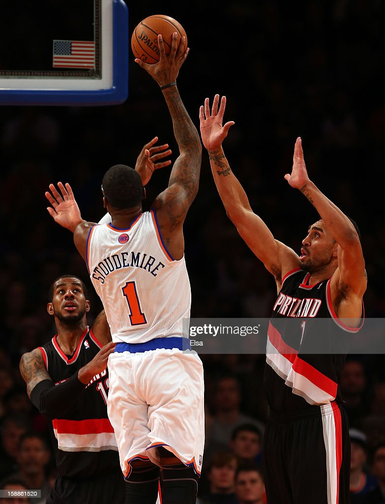 Amar'e Stoudemire #1 of the New York Knicks takes a shot as LaMarcus Aldridge #12 and Jared Jeffries #1 of the Portland Trail Blazers defend on January 1, 2013 at Madison Square Garden in New York City.