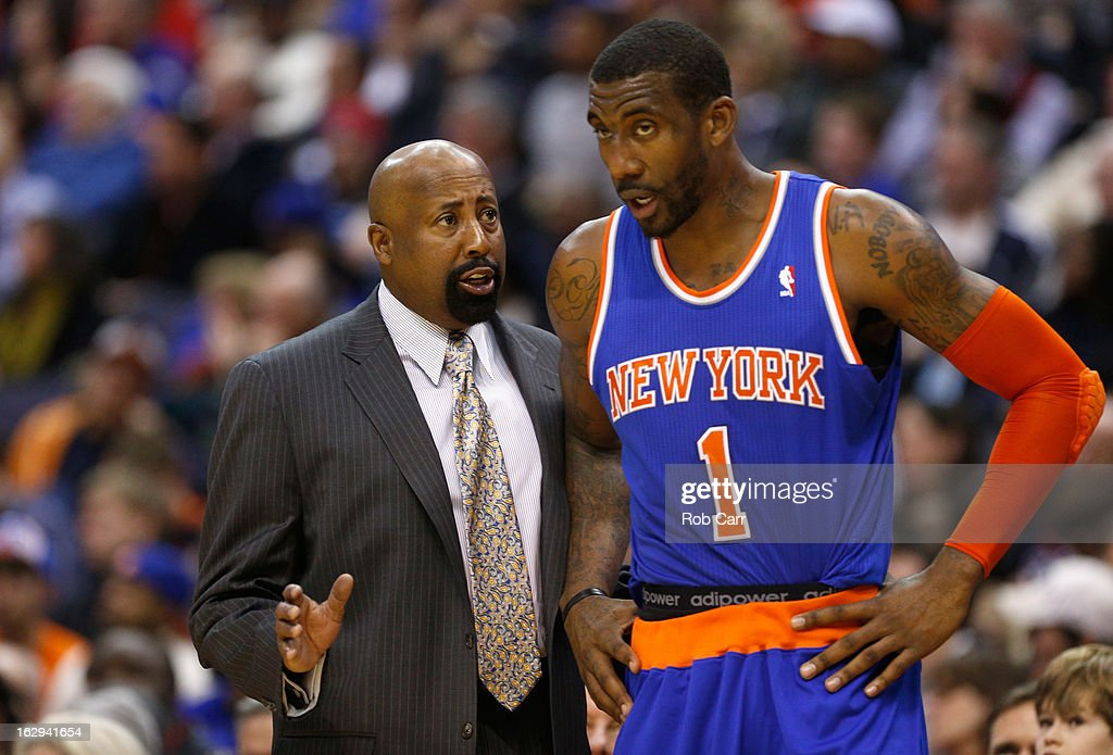 Amar'e Stoudemire #1 of the New York Knicks talks with head Mike Woodson during the second half of the Knicks 96-88 win over the Washington Wizards at Verizon Center on March 1, 2013 in Washington, DC.