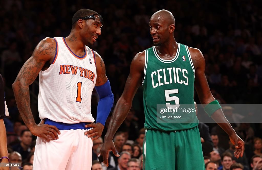 Amar'e Stoudemire #1 of the New York Knicks talks with Kevin Garnett #5 of the Boston Celtics at Madison Square Garden on January 7, 2013 in New York City. The Celtics defeated the Knicks 102-96.