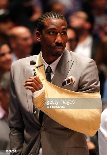 Amare Stoudemire of the New York Knicks wears a sling on his left arm due to a cut on his hand against the Miami Heat in Game Three of the Eastern...