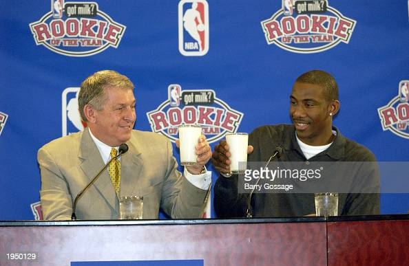 Amare Stoudemire of the Phoenix Suns and Phoenix Suns Chairman and CEO Jerry Colangelo toast the 200203 Got Milk NBA Rookie of the Year award on...
