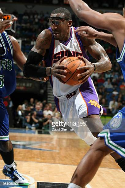 Amar'e Stoudemire of the Phoenix Suns breaks through the defense of Al Jefferson and Ryan Gomes of the Minnesota Timberwolves during the game on...