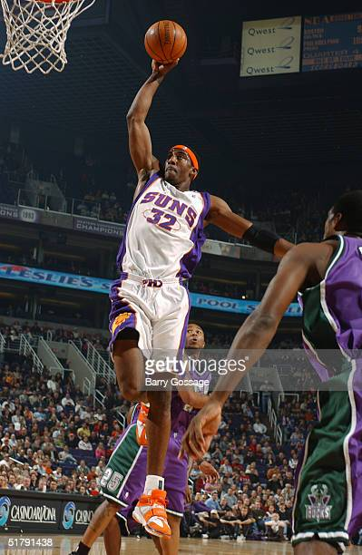 Amare Stoudemire of the Phoenix Suns dunks against the Milwaukee Bucks November 24 2004 at America West Arena in Phoenix Arizona NOTE TO USER User...