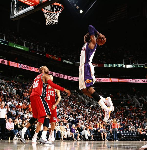 58a4221bf ... REEBOK NBA SEWN JERSEY VINTAGE Amare Stoudemire 1 of the Phoenix Suns  dunks against Vince Carter 15 of the ...