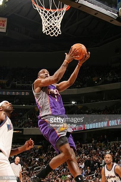 Amare Stoudemire of the Phoenix Suns goes to the basket against the Washington Wizards at the Verizon Center on January 23 2007 in Washington DC The...