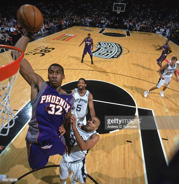 Amare Stoudemire of the Phoenix Suns goes up for a dunk past Tony Parker of the San Antonio Spurs in Game three of the Western Conference Finals...