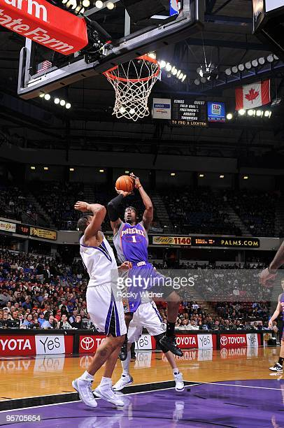Amar'e Stoudemire of the Phoenix Suns goes up for a shot against Kenny Thomas of the Sacramento Kings during the game at Arco Arena on January 5 2010...