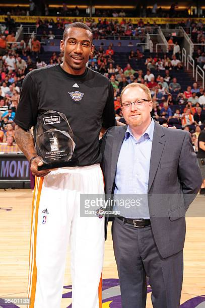 Amare Stoudemire of the Phoenix Suns is presented the Kia Western Conference Player of the Month Award for March by David Griffin Phoenix Suns Senior...