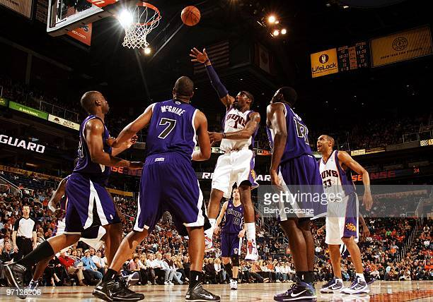 Amar'e Stoudemire of the Phoenix Suns puts up a shot against Carl Landry Dominic McGuire and Tyreke Evans of the Sacramento Kings during the game at...