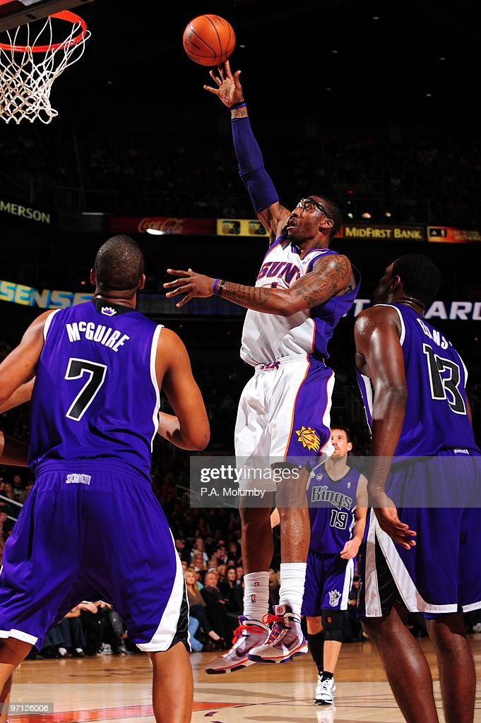 Amar'e Stoudemire of the Phoenix Suns puts up a shot against Dominic McGuire and Tyreke Evans of the Sacramento Kings during the game at US Airways...