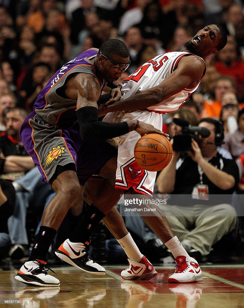 Amar'e Stoudemire of the Phoenix Suns runs into Hakim Warrick of the Chicago Bulls at the United Center on March 30 2010 in Chicago Illinois The Suns...