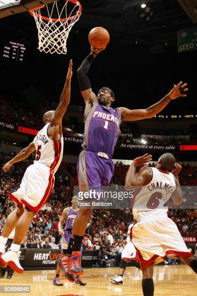 Amar'e Stoudemire of the Phoenix Suns shoots against Quentin Richardson and Mario Chalmers of the Miami Heat on November 3 2009 at American Airlines...