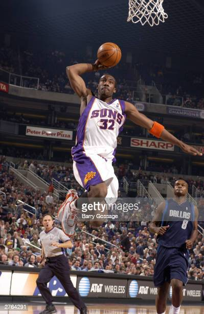 Amare Stoudemire of the Phoenix Suns shoots against the Dallas Mavericks at America West Arena on November 26 2003 in Phoenix Arizona NOTE TO USER...