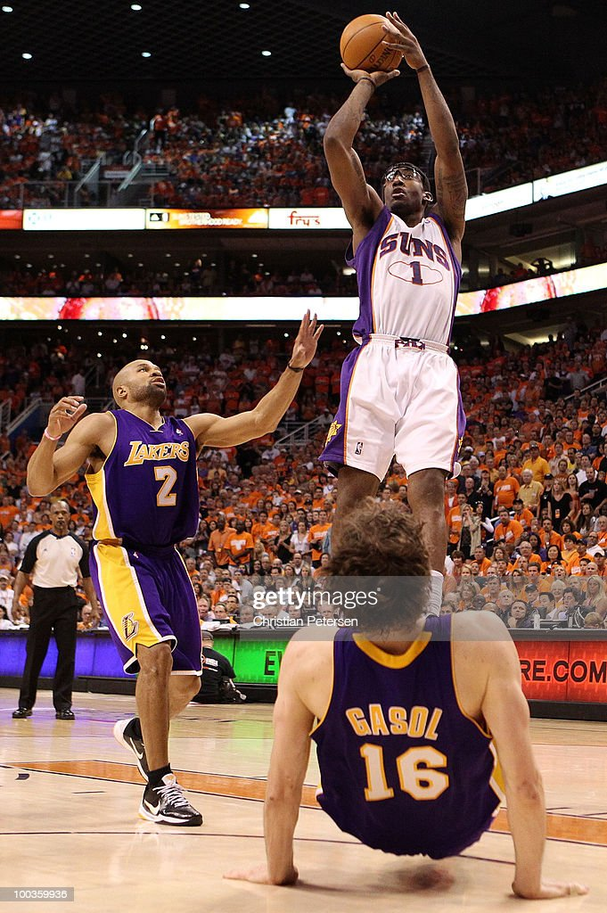 Amar'e Stoudemire #1 of the Phoenix Suns takes a shot over Pau Gasol #16 of the Los Angeles Lakers in the fourth quarter of Game Three of the Western Conference Finals during the 2010 NBA Playoffs at US Airways Center on May 23, 2010 in Phoenix, Arizona.