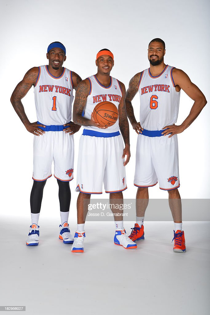 Amar'e Stoudemire #1, Tyson Chandler #6, and Carmelo Anthony #7 of the New York Knicks pose for a portrait at Media Day on September 30, 2013 at Madison Square Garden in New York City, New York.