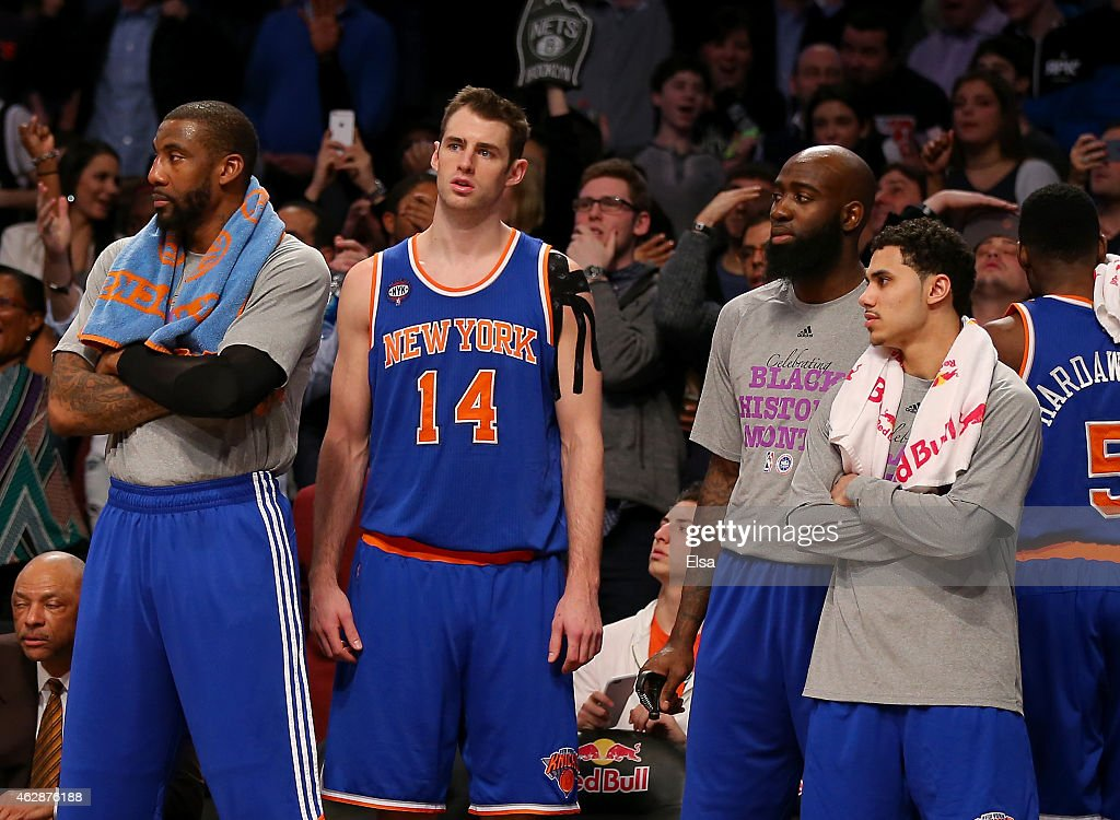 Amar'e StoudemireJason SmithQuincy Acy and Shane Larkin of the New York Knicks react after Alan Anderson of the Brooklyn Nets hit a three point shot...