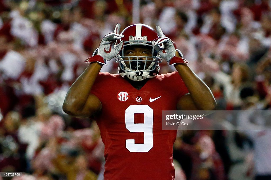 <a gi-track='captionPersonalityLinkClicked' href=/galleries/search?phrase=Amari+Cooper&family=editorial&specificpeople=8797589 ng-click='$event.stopPropagation()'>Amari Cooper</a> #9 of the Alabama Crimson Tide celebrates after catching a 39 yard touchdown pass thrown by Blake Sims #6 in the third quarter against the Auburn Tigers during the Iron Bowl at Bryant-Denny Stadium on November 29, 2014 in Tuscaloosa, Alabama.