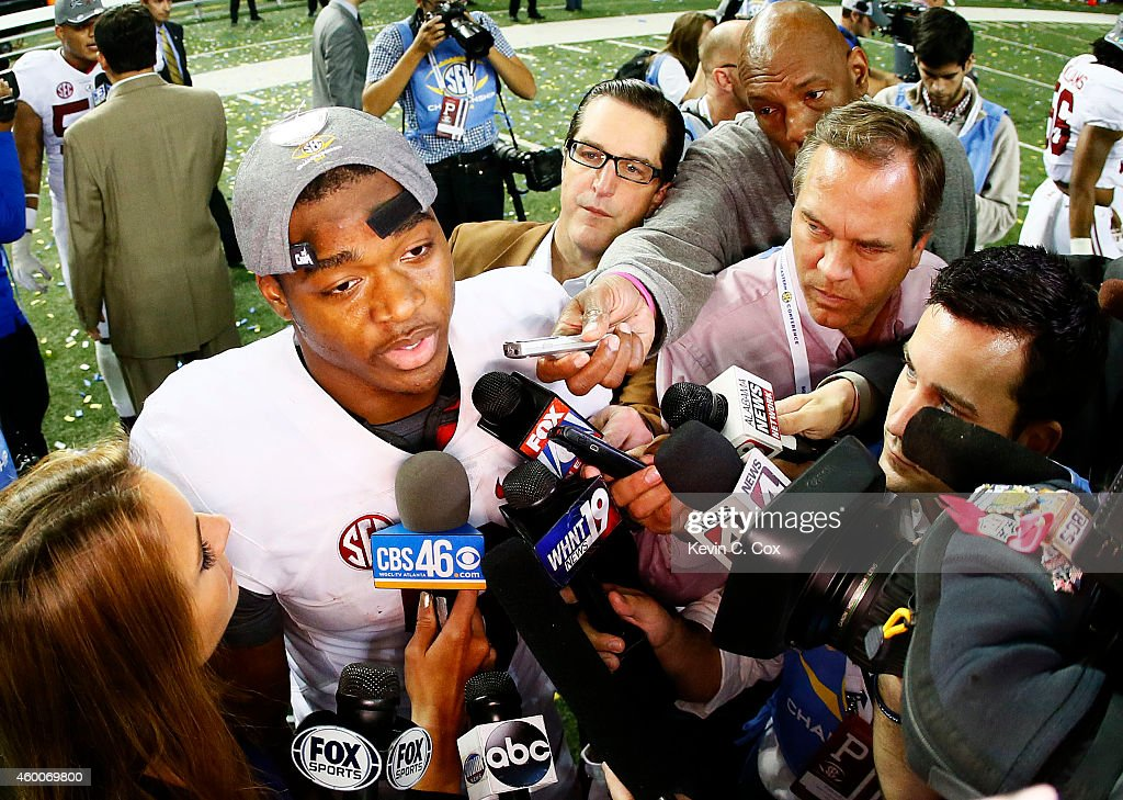 <a gi-track='captionPersonalityLinkClicked' href=/galleries/search?phrase=Amari+Cooper&family=editorial&specificpeople=8797589 ng-click='$event.stopPropagation()'>Amari Cooper</a> #9 of the Alabama Crimson Tide celebrates their 42 to 13 win over the Missouri Tigers in the SEC Championship game at the Georgia Dome on December 6, 2014 in Atlanta, Georgia.