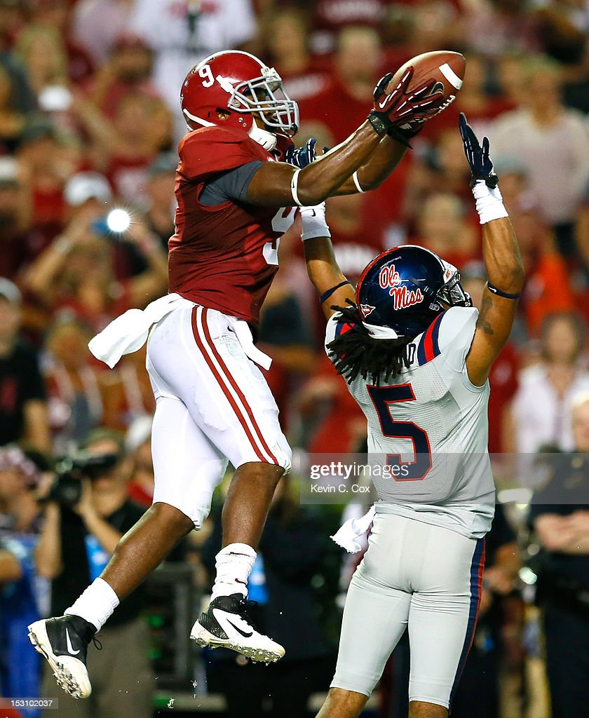 Amari Cooper #9 of the Alabama Crimson Tide pulls in this touchdown reception over the hands of Frank Crawford #5 of the Mississippi Rebels at Bryant-Denny Stadium on September 29, 2012 in Tuscaloosa, Alabama.