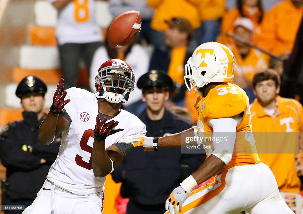 Amari Cooper #9 of the Alabama Crimson Tide pulls in this touchdown reception against LaDarrell McNeil #33 of the Tennessee Volunteers at Neyland Stadium on October 20, 2012 in Knoxville, Tennessee.