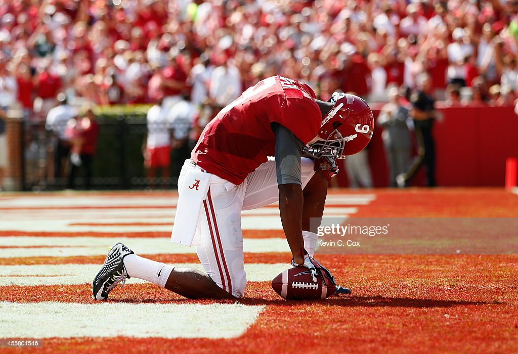 <a gi-track='captionPersonalityLinkClicked' href=/galleries/search?phrase=Amari+Cooper&family=editorial&specificpeople=8797589 ng-click='$event.stopPropagation()'>Amari Cooper</a> #9 of the Alabama Crimson Tide reacts after taking a reception in for a touchdown against the Florida Gators at Bryant-Denny Stadium on September 20, 2014 in Tuscaloosa, Alabama.