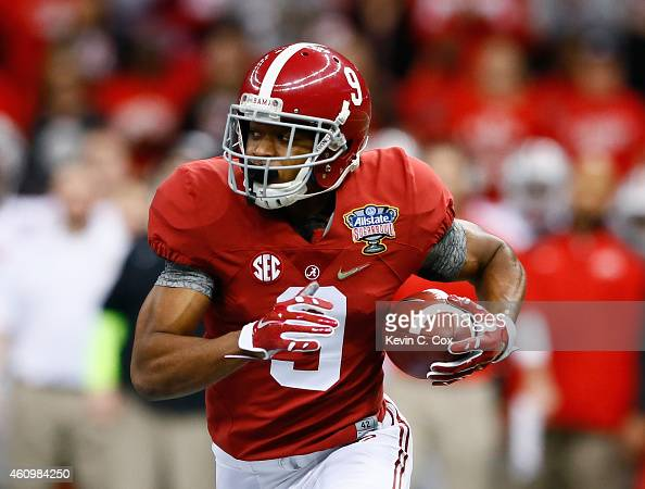 Amari Cooper of the Alabama Crimson Tide runs the ball in the first quarter against the Ohio State Buckeyes during the All State Sugar Bowl at the...