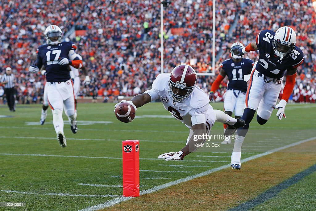 <a gi-track='captionPersonalityLinkClicked' href=/galleries/search?phrase=Amari+Cooper&family=editorial&specificpeople=8797589 ng-click='$event.stopPropagation()'>Amari Cooper</a> #9 of the Alabama Crimson Tide rushes for 28 yards in the second quarter for a first down against the defense of Ryan Smith #24 of the Auburn Tigers at Jordan-Hare Stadium on November 30, 2013 in Auburn, Alabama.