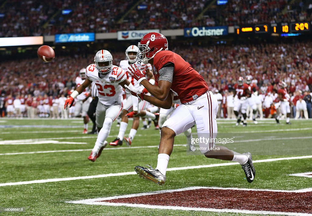 <a gi-track='captionPersonalityLinkClicked' href=/galleries/search?phrase=Amari+Cooper&family=editorial&specificpeople=8797589 ng-click='$event.stopPropagation()'>Amari Cooper</a> #9 of the Alabama Crimson Tide scores a touchdown in the first quarter against the Ohio State Buckeyes during the All State Sugar Bowl at the Mercedes-Benz Superdome on January 1, 2015 in New Orleans, Louisiana.