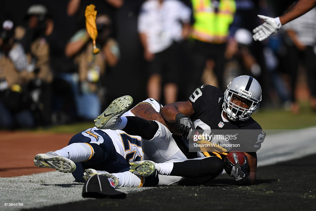 Amari Cooper #89 of the Oakland Raiders catches the ball in the endzone against the San Diego Chargers during their NFL game at Oakland-Alameda County Coliseum on October 9, 2016 in Oakland, California. The play would be flagged for pass interference but the pass incomplete.