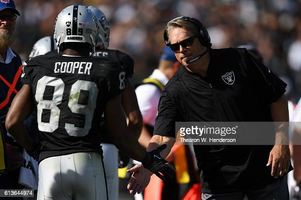 Amari Cooper of the Oakland Raiders celebrates with head coach Jack Del Rio of the Oakland Raiders after scoring on a twopoint conversion during...