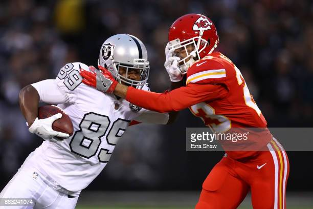 Amari Cooper of the Oakland Raiders is pushed out of bounds by Phillip Gaines of the Kansas City Chiefs during their NFL game at OaklandAlameda...