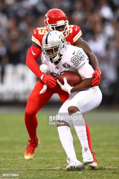 Amari Cooper of the Oakland Raiders makes a catch against the Kansas City Chiefs during their NFL game at OaklandAlameda County Coliseum on October...