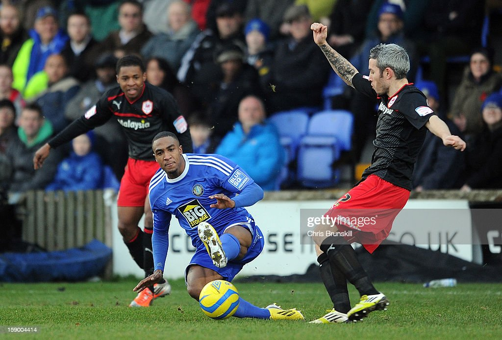 Amari Morgan-Smith(L) of Macclesfield Town tackles Kevin McNaughton of Cardiff City during the FA Cup with Budweiser Third Round match between Macclesfield Town and Cardiff City at Moss Rose Ground on January 5, 2013 in Macclesfield, England.
