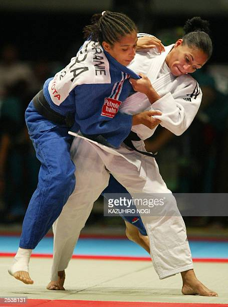Amarilis Savon of Cuba throws Annabelle Euranie of France during the women's under 52 kg class final match at the World Judo Championships in Osaka...